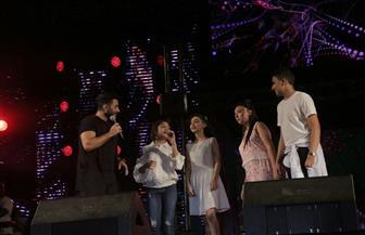 تامر حسني يشعل حفل نادي الشمس وسط حضور الآلاف من جمهوره | صور
