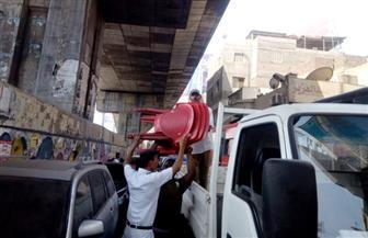حملة لإزالة الإشغالات وإعادة الانضباط المروري بـ5 كباري في القاهرة| صور