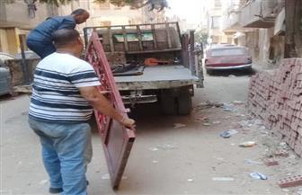 حملة لإزالة مخلفات المباني والإشغالات بالعمرانية | صور