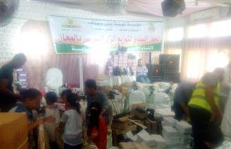 توزيع الزي المدرسي على 5 آلاف أسرة فقيرة في بني سويف  صور