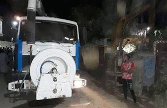 تطهير ماسورة صرف صحي بمنطقة الأقالتة بالأقصر بعد تسببها في سقوط 3 مبان  صور
