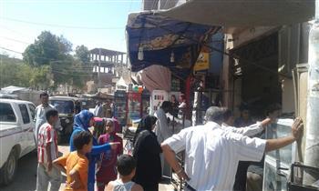 حملات مكثفة بقرى ومراكز أسيوط لإزالة الإشغالات من أمام المدارس | صور