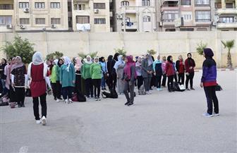 طلاب جامعة المنصورة يؤدون تحية العلم في أول أيام العام الدراسي الجديد