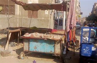 حملة مكبرة لإزالة الإشغالات بشارع رياض بأسيوط | صور