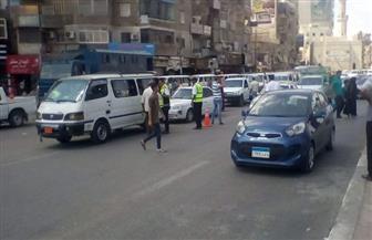 حملات أمنية بميادين السويس ورفع الإشغالات | صور
