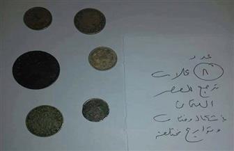 إحباط تهريب عملات أثرية بمطار برج العرب بالإسكندرية | صور