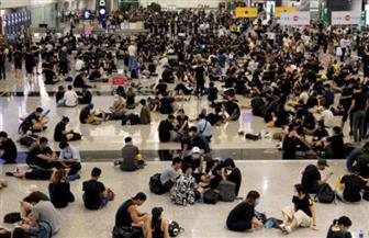 المحتجون يتدفقون على شوارع هونج كونج مع احتفال الصين بذكرى تأسيسها
