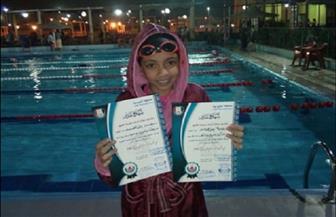 يمنى محمد تحقق المركز الثاني في بطولة السباحة الودية بالعبور
