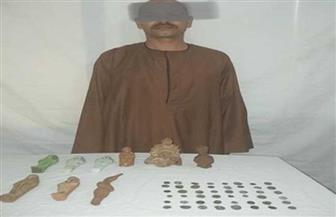 ضبط 57 قطعة أثرية من عصور مختلفة بحوزة عامل قبل بيعها بأسيوط