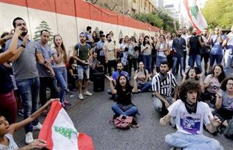"""مناصرون لحزب الله وحليفته """"أمل"""" يهاجمون متظاهرين في بيروت"""