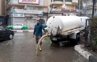 """إعادة فتح طريق """" أسيوط"""" بعد شفط مياه الأمطار"""