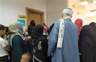 الكشف على 1250 مريضا مجانا بقرية الجواهين في سوهاج| صور