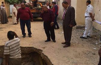 بدء إصلاح هبوط أرضي مفاجئ بمنطقة الهانوفيل في الإسكندرية | صور