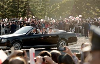 موكب إمبراطور اليابان وزوجته يجوب طوكيو بمناسبة اعتلاء العرش| صور