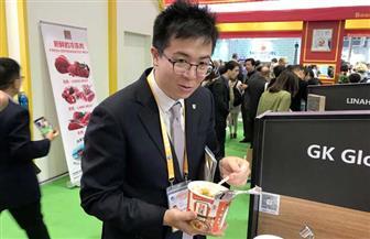 الكشري المصري يخطف أنظار الصينيين في معرض شانغهاي للاستيراد | صور