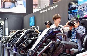 لأول مرة.. روبوت يزرع الشعر وآخر متعدد المواهب بمعرض شانغهاي | صور