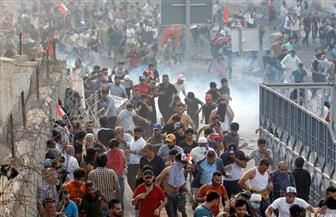 متظاهرون يتوافدون على ساحة التحرير ببغداد في ذكرى النصر على داعش