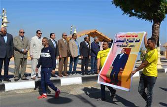 مسيرة بالأعلام وأطفال يرتدون زيا فرعونيا في احتفالات الأقصر بعيدها القومي | فيديو وصور