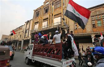 احتفالات في ساحة التحرير بالعراق عقب إعلان رئيس الوزراء استقالته