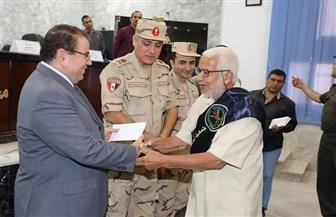 تكريم 257 من أسر الشهداء ومصابي العمليات الحربية بسوهاج | صور