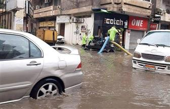طوارئ بالإسكندرية لمواجهة مياه الأمطار الغزيرة.. واستمرار حركة السفن |صور