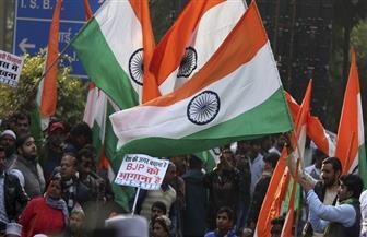 مسلمون يلوحون بأعلام الهند لإظهار أن احتجاجاتهم ليست ضد الدولة
