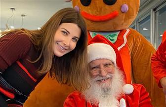 نانسي عجرم تهنئ جمهورها بأعياد الكريسماس