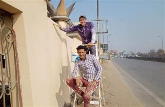 طلاء السور الخارجي لمساكن هضبة الأهرام | صور