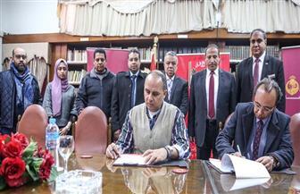 الأهلي يوقع عقدا مع أحد البنوك لإنشاء فرع بمقر الشيخ زايد  صور