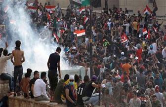القوات العراقية تطلق قنابل الغاز لتفريق محتجين أمام مقر السفارة الأمريكية