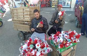 توافد باعة بابا نويل والطرابيش للاحتفال برأس السنة الجديدة في أسوان | صور