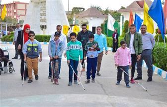 جامعة بني سويف تحتفل باليوم العالمي لمتحدي الإعاقة | صور