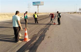 إصلاح الطريق الدولي بجنوب سيناء من آثار السيول تجنبا لحوادث السير | صور