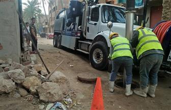حملة موسعة لتطهير شبكات الصرف الصحى بالقاهرة | صور
