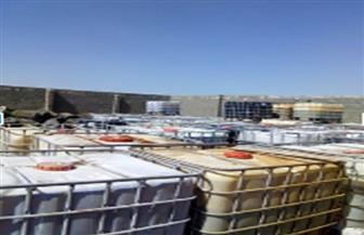 ضبط 200 طن زيوت عطرية شديدة الخطورة داخل مخزن غير مرخص بالإسكندرية | صور