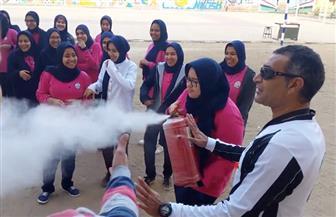 تدريب طالبات إحدى المدارس بالمنوفية على أعمال الإطفاء والإنقاذ بمناسبة اليوم العالمى للحماية المدنية