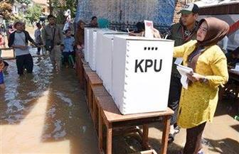 رغم الفيضانات.. الإندونيسيون يتوافدون على مراكز الاقتراع | صور