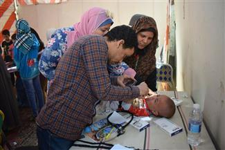 الكشف على 1360 مريضا في قافلة طبية لجامعة سوهاج بقرية أولاد علي | صور