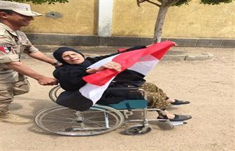 مسنة تدلي بصوتها فى التعديلات الدستورية على كرسي متحرك بالسنطة