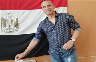 وائل جمعة يشارك فى الاستفتاء على الدستور بسفارة مصر فى قطر | صور