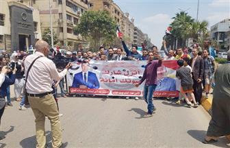 مسيرة لحزب الحرية المصرى بالعمرانية لحث المواطنين على المشاركة فى الاستفتاء