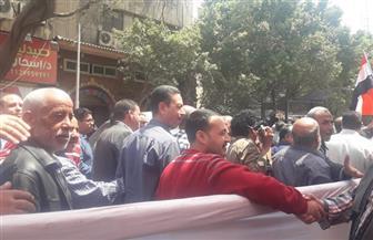 مسيرة حاشدة للعاملين بمؤسسة الأهرام دعما للاستفتاء على التعديلات الدستورية | صور