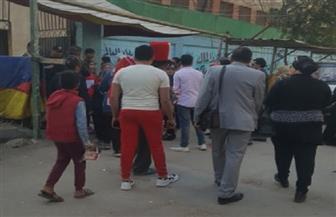 إقبال كثيف من الناخبين فى اليوم الأخير للاستفتاء على الدستور بإمبابة | صور