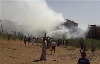 السيطرة على حريق بقطعة أرض وشقة في سوهاج
