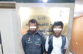 هاربان من 21 قضية.. ضبط عاطلين بحوزتهما 2 كيلو حشيش وأسلحة بيضاء فى طنطا