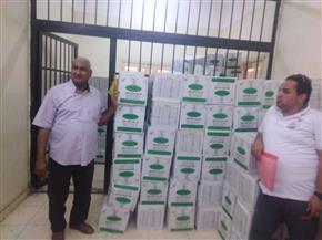 توزيع 1500 كرتونة مواد غذائية بالأقصر | صور