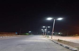 تركيب 192 عمود إنارة وكشاف ليد بمدينة الطود بالأقصر | صور