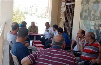 رئيس جهاز القاهرة الجديدة يجيب على تساؤلات وشكاوى السكان فى بث مباشر على الفيس بوك  صور