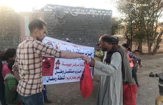 مستقبل وطن سوهاج يوزع 500 شنطة على الأسر الأكثر احتياجا بمركز جهينة