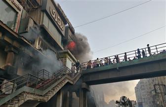 شهود عيان: تاجر ملابس يدخل في غيبوبة بعد احتراق محله في الموسكي